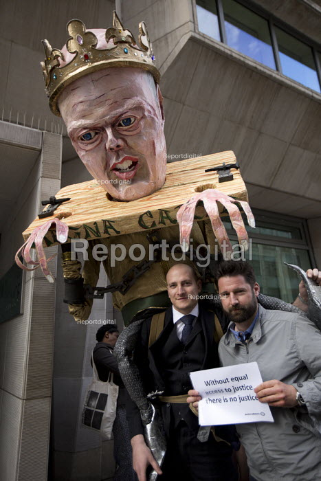 Russell Fraser, barrister. Pre election farewell Party for Puppet Chris Grayling at the Ministry of Justice. Against the reorganisation of criminal defence, cuts to legal aid and the banning of books for prisoners. Organised by the Justice Alliance. London. - Jess Hurd - 2015-05-05