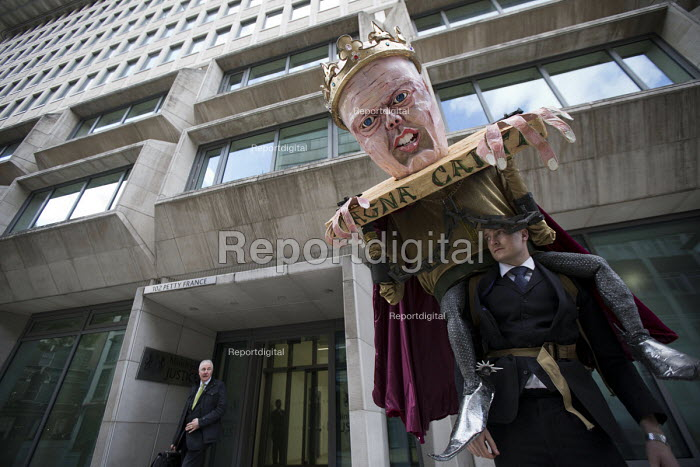 Pre election farewell Party for Puppet Chris Grayling at the Ministry of Justice. Against the reorganisation of criminal defence, cuts to legal aid and the banning of books for prisoners. Organised by the Justice Alliance. London. - Jess Hurd - 2015-05-05