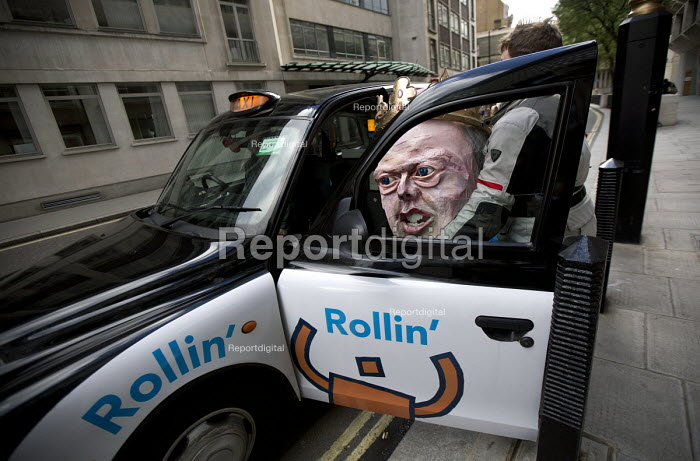 Taxi for Mr Grayling. Pre election farewell Party for Puppet Chris Grayling MP at the Ministry of Justice. Against the reorganisation of criminal defence, cuts to legal aid and the banning of books for prisoners. Organised by the Justice Alliance. London. - Jess Hurd - 2015-05-05