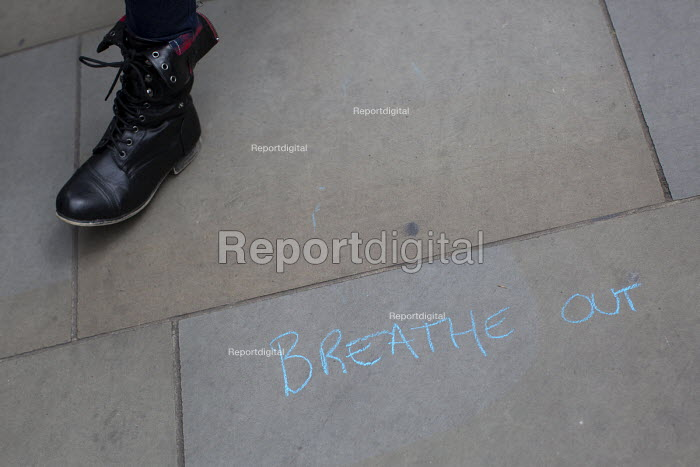 Breathe Out - street graffiti as David Cameron announces his majority government after winning the General Election. Parliament Square, London. - Jess Hurd - 2015-05-08