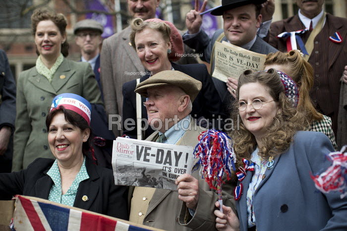 People dress in 1940s vintage period costumes. VE Day (Victory in Europe Day) celebrations marking 70 years since the defeat of Germany in WW2, the end of the second world war in Europe. Whitehall. London. - Jess Hurd - 2015-05-08