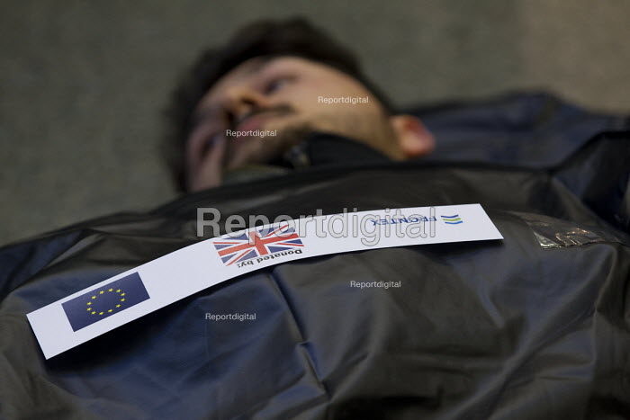 No Borders die-in at St Pancras Eurostar Terminal. Marking the tenth anniversary Frontex, the EU border agency, with body bags representing the 20,000 known migrant deaths at sea. London. - Jess Hurd - 2015-05-19