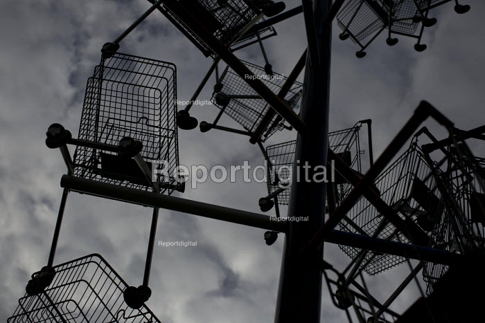 Detail from a sculpture of shopping trolleys called DNA DL90 on a site opposite an Amazon warehouse. The artwork by Abigail Fallis is part of The Line: a new modern art walk. Newham. East London. Commissoned by the supermarket Somerfield to create an artwork for the Muscular Dystrophy charity. - Jess Hurd - 2015-05-23