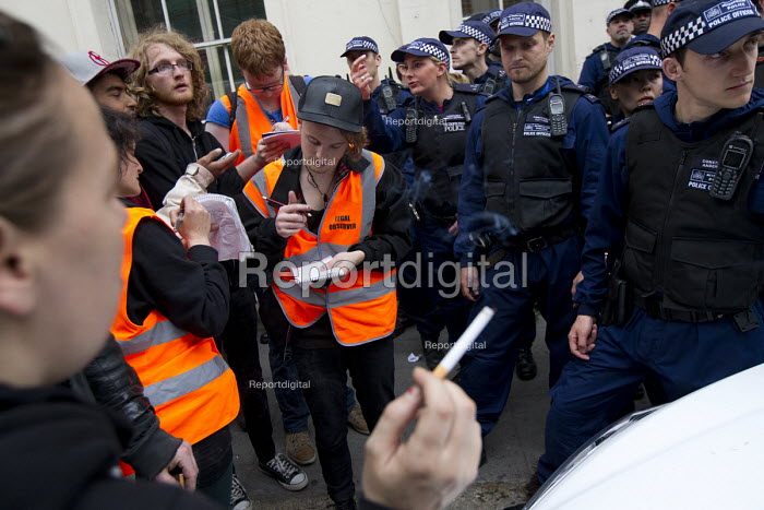 Legal observers outside an illegal squat eviction by police in Mayfair. Anti austerity protests on the day of the Queens Speech and opening of Parliament. London. - Jess Hurd - 2015-05-27