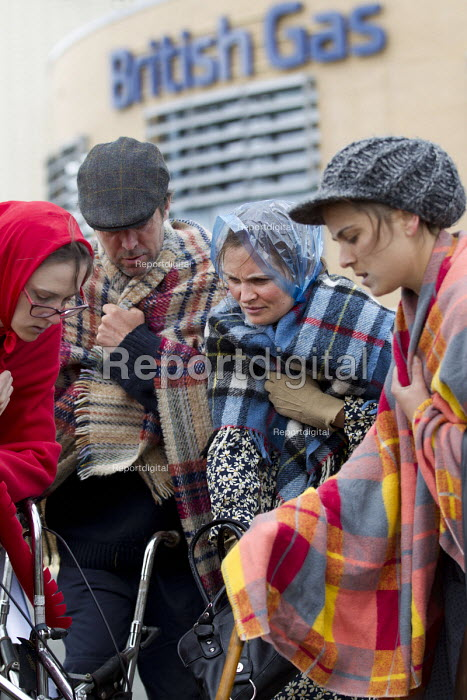 Protest by activists dressed as cold shivering pensioners outside British Gas, Oxford HQ against fuel poverty. Environmental activists delivered to British Gas Headquarters a Bill for funeral costs for the thousands of customers who died from fuel poverty last year. Reclaim The Power protest, Oxfordshire. - Jess Hurd - 2015-06-01
