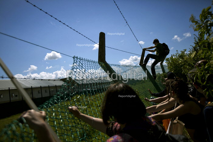 Protesters pull the fence down. Surround Yarls Wood, End... - Jess Hurd, jj1506037.jpg