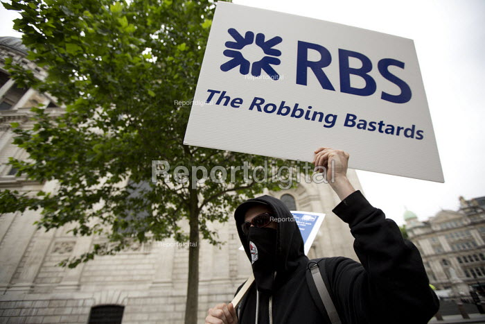 RBS - The Robbing Bastards placard. Peoples Assembly Against Austerity protest against cuts in anti-austerity march. London. - Jess Hurd - 2015-06-20