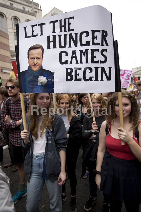 Let The Hunger Games Begin placard. Peoples Assembly Against Austerity protest against cuts in anti-austerity march. London. - Jess Hurd - 2015-06-20
