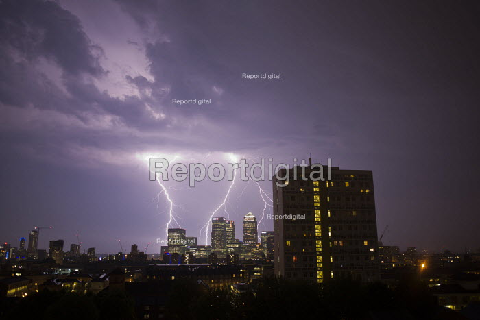 Lightening bolts strike financial buildings, including Barclays, CitiBank and JP Morgan. Canary Wharf. Docklands, East London. - Jess Hurd - 2015-07-03
