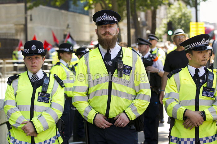 Hipster policeman as Anti racists protest against a small group of fascists alleging the Jewification of Britain. They were banned from Golders Green. Westminster, London. - Jess Hurd - 2015-07-04