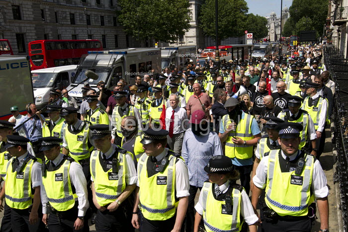 Police escort a small group of fascists alleging the Jewification of Britain. They were banned from Golders Green. Westminster, London. - Jess Hurd - 2015-07-04