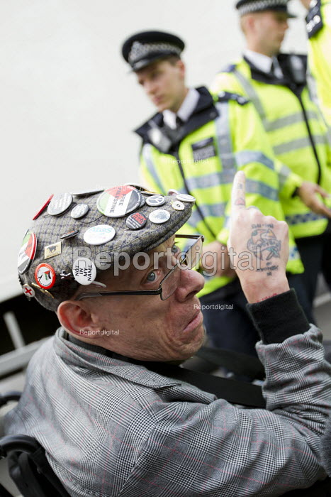 Disabled campaigner blocking the road. Balls To The Budget, Disabled People Against Cuts throwing balls at Downing Street as George Osborne leaves to deliver his budget to Parliament. Westminster. London - Jess Hurd - 2015-07-08