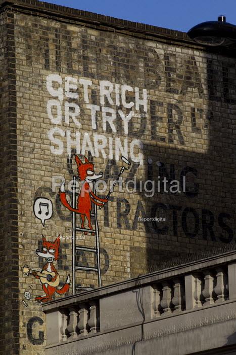Get Rich Or Try Sharing. Camden graffiti. Camden. London. - Jess Hurd - 2015-07-11
