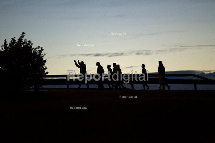 Migrants try to jump onto railway trucks Calais Eurostar Terminal France - Jess Hurd - 2015-08-06
