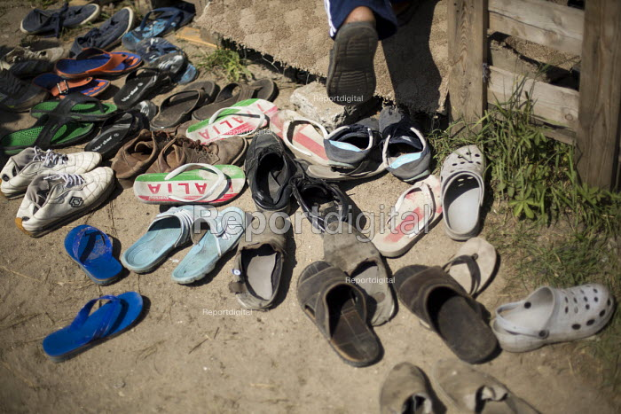 Friday prayers in a makeshift Mosque Calais refugee camp The Jungle France. - Jess Hurd - 2015-08-07