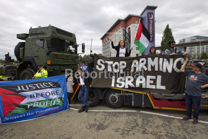 Stop DSEi arms fair protest prevents military vehicle entering ExCel centre London Stop Arming Israel. Defence Security and Equipment International exhibition - Jess Hurd - 2015-09-07