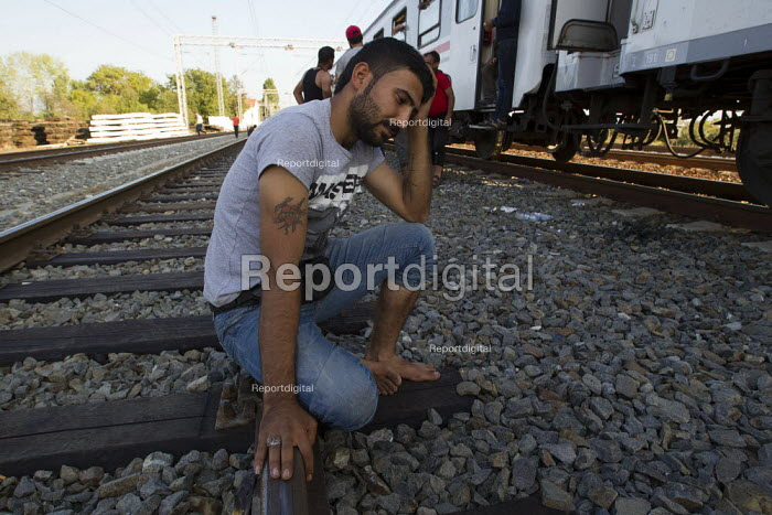 Opatovak refugee waiting for a train leaving Tovarnik railway station to an unknown destination. Croatia. - Jess Hurd - 2015-09-23