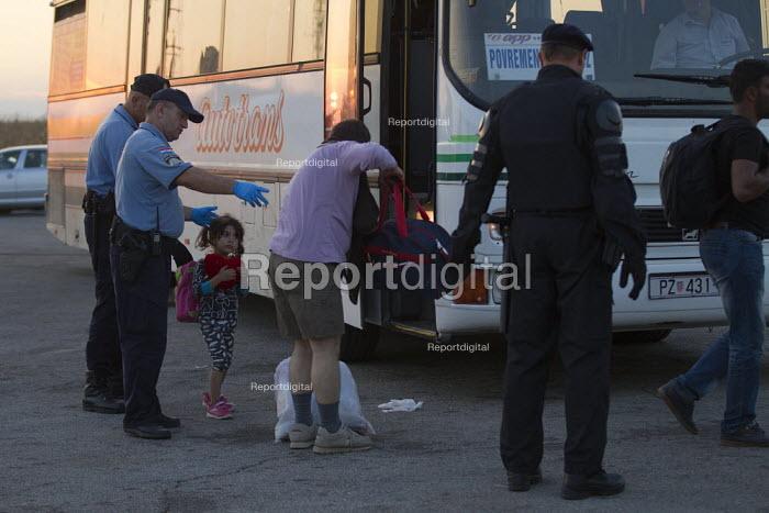 Exhausted refugees arrive at Opatovak refugee camp. Croatia. - Jess Hurd - 2015-09-23