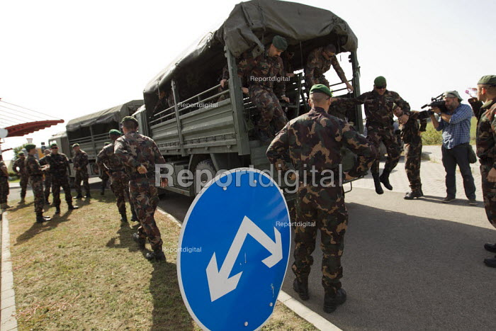 Military build up ahead of refugees using the Beremend, Hungarian border crossing. Hungary. - Jess Hurd - 2015-09-19