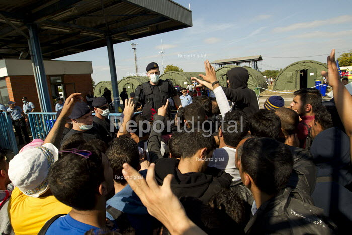 Exhausted refugees wait to be selected by riot police to access the overcrowded Opatovac refugee camp. Croatia. - Jess Hurd - 2015-09-22