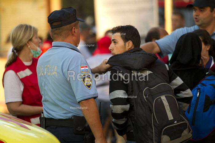 Refugee tries to board a bus to Austria out of turn at Opatovac refugee camp. Croatia. - Jess Hurd - 2015-09-22