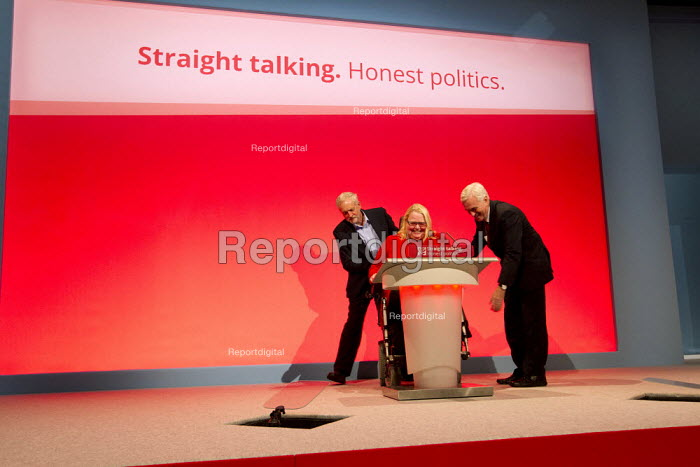 Jeremy Corbyn and John McDonnell MP help Candy Atherton a disabled delegate. Labour Party Conference, Brighton. - Jess Hurd - 2015-09-28
