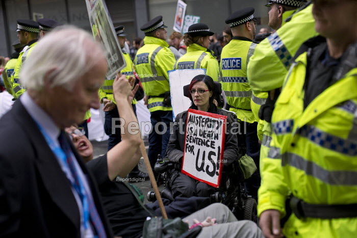 Delegate passing disability rights protest Conservative Party Conference, Manchester. - Jess Hurd - 2015-10-05