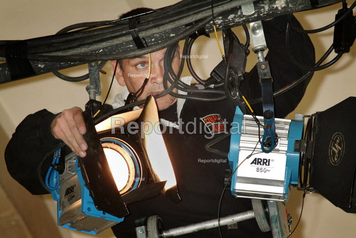 Lighting engineer adjusting the stage lights. - Paul Carter - 2003-10-21