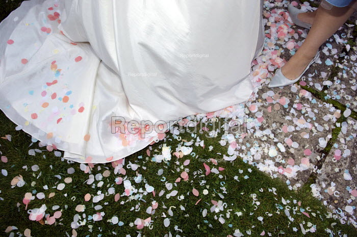 Confetti on the ground at a white wedding. - Paul Carter - 2007-10-06