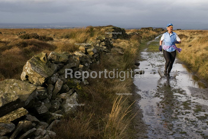 Woman running along a footpath on Wheelton Moor, near Brinscall, Lancashire - Paul Carter - 2007-12-01