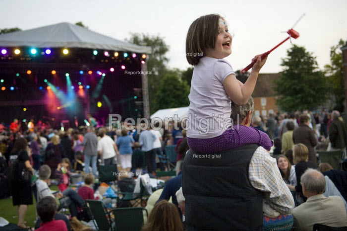 Child sitting on her father's shoulders, enjoying live music at an open air festival. - Paul Carter - 2008-06-07