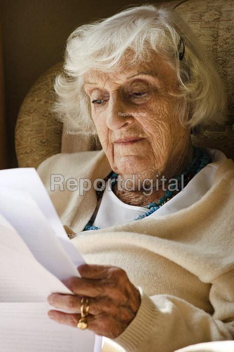 Portrait of an elderly woman sitting in a chair, reading. - Paul Carter - 2008-09-15