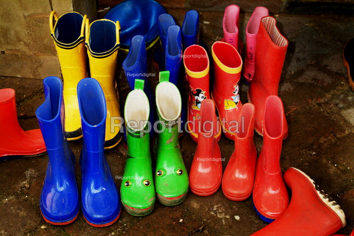 Brightly coloured wellington boots outside a nursery school. - Paul Carter - 2004-03-01