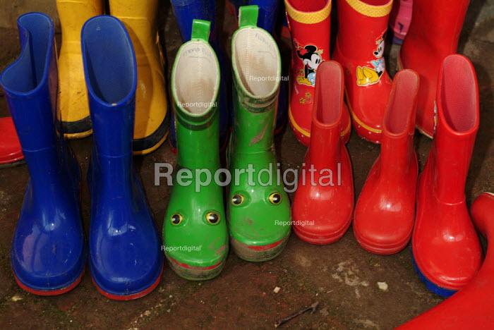 Brightly coloured wellington boots outside a nursery school. - Paul Carter - 2004-03-01