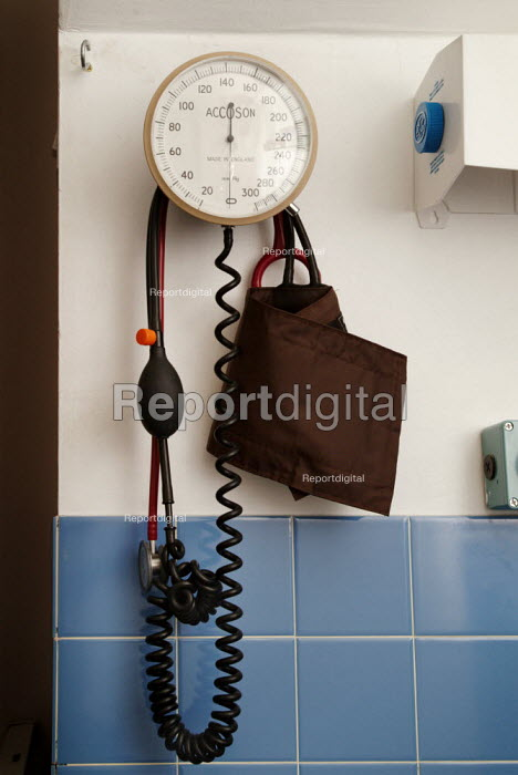 Equipment for measuring blood pressure, hanging on the wall, in medical room. - Paul Carter - 2004-09-22