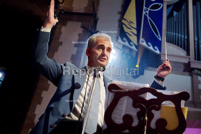 Conductor conducting the band and congregation in Portsmouth Cathedral. - Paul Carter - 2005-07-11