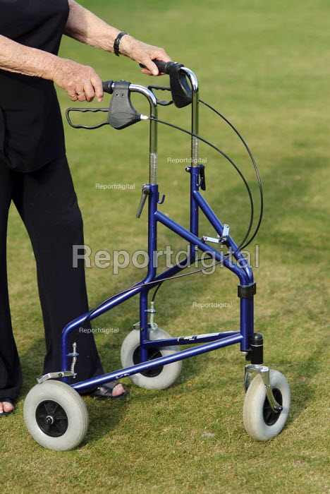 An elderly woman with her wheeled walker. - Paul Carter - 2005-07-11