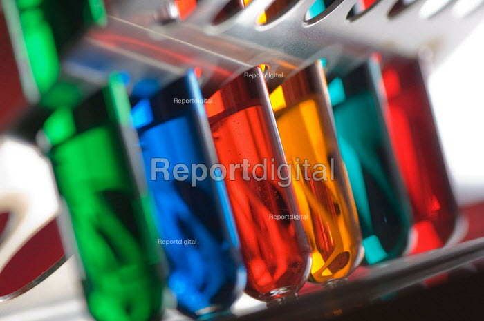 Test tubes with different coloured liquids, in a science lesson at a secondary school. - Paul Carter - 2007-07-10