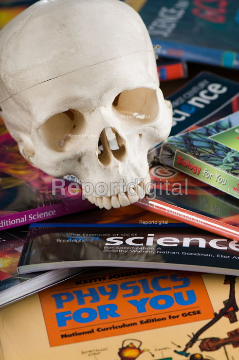 A human skull and numerous science textbooks, in a science lesson at a secondary school. - Paul Carter - 2007-07-10