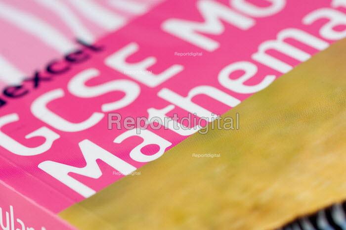 GCSE Maths textbook, in a Maths lesson at a secondary school. - Paul Carter - 2007-07-10