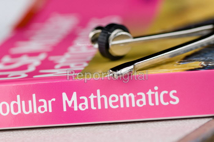GCSE Maths textbook and a protractor in a Maths lesson at a secondary school. - Paul Carter - 2007-07-10