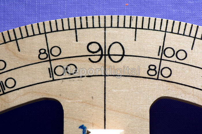 A wooden protractor, in a Maths lesson at a secondary school. - Paul Carter - 2007-07-10