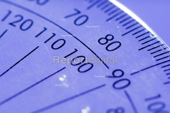 A plastic protractor, in a Maths lesson at a secondary school. - Paul Carter - 2007-07-10