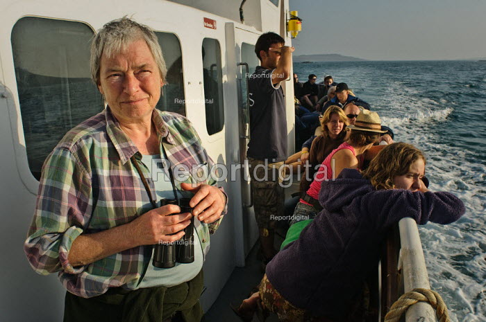 Woman with binoculars, on a boat trip. Tresco, Isles of Scilly. - Paul Carter - 2008-10-12