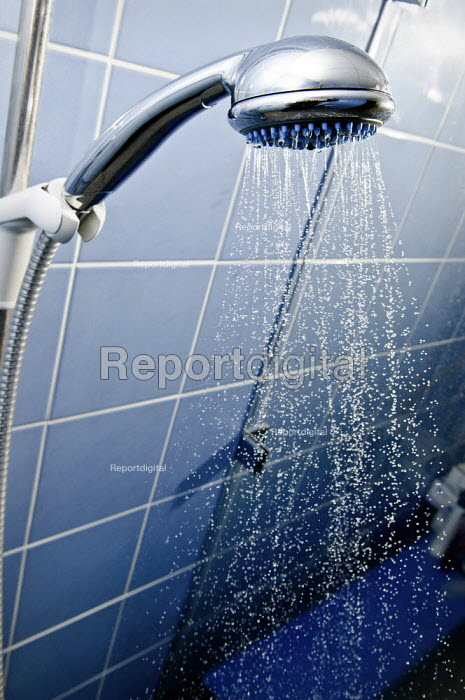 Water spraying from a showerhead in a specialist shower toilet for disabled in a hospice. - Paul Carter - 2009-02-20
