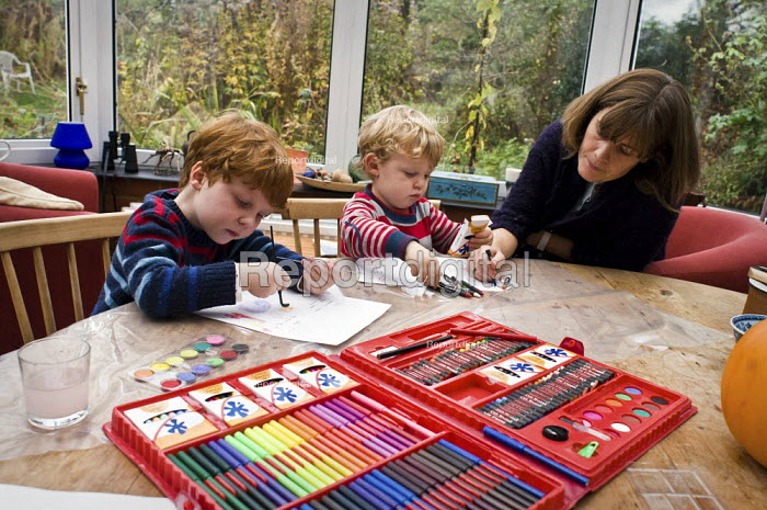 Two brothers painting and drawing with their mother. - Paul Carter - 2009-10-24