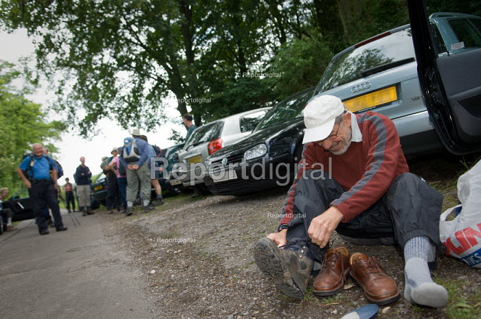 A member of the Ramblers Association putting on his walking boots. The group have parked their cars and met for a walk. - Paul Carter - 2007-06-16