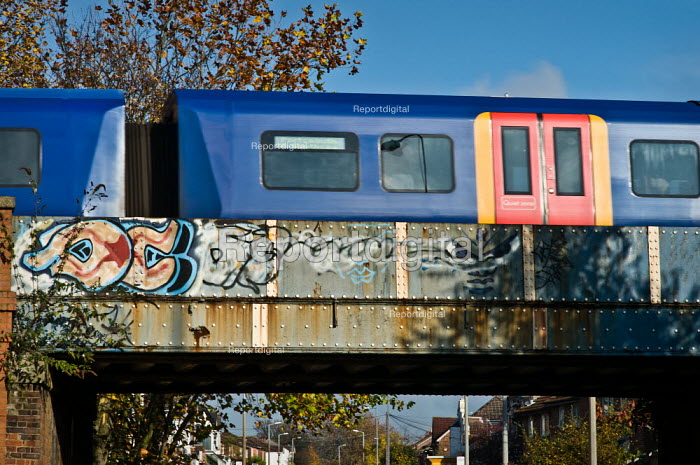 South West train going over a bridge over a road. - Paul Carter - 2010-10-07