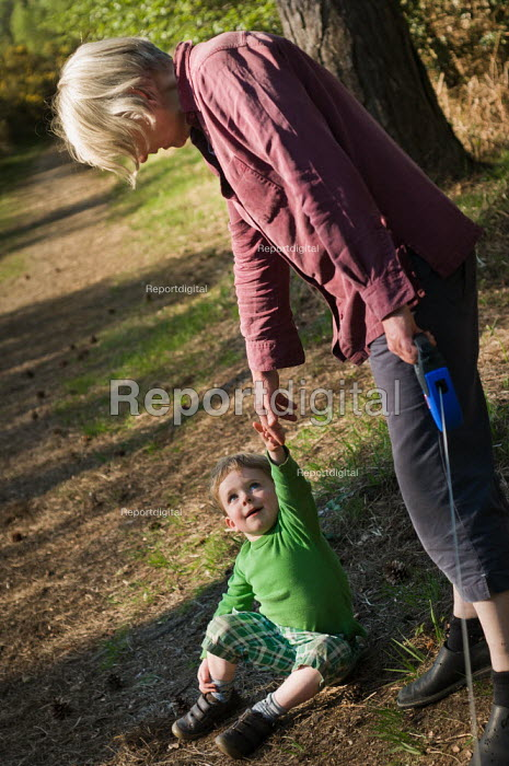 A grandmother and grandson on a walk in Norley Wood, The New Forest. - Paul Carter - 2011-04-20