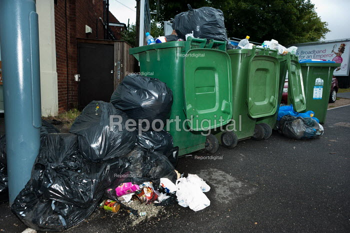 Uncollected rubbish overflowing during a two week strike over new contracts and pay cuts by Southampton dustmen. Strikes against council austerity cuts, Southampton - Paul Carter - 2011-06-13